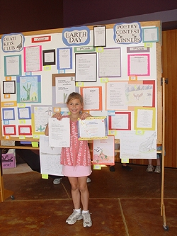 Ashley poses with her poem
