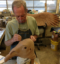 Exhibits staff sculpting vulture head